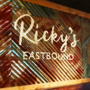 Ricky's Eastbound restaurant signage on sheet metal